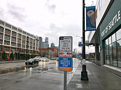 Free Waterfront Shuttle Stop - load zone sign in front of the Aquarium (Seattle Department of Transportation) Tags: seattle sdot transportation waterfront shuttle load znoe pay by phone parking sign bus only aquarium otter flag sidewalk