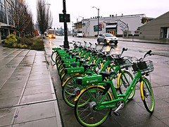 Lime E Bike - waiting for riders down at the waterfront (Seattle Department of Transportation) Tags: seattle sdot transportation waterfront lime ebikes bikes electric parking onstreet anthonys green