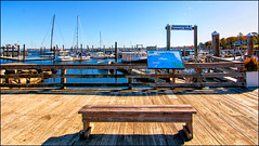 Waiting for the Ferry (Timothy Valentine) Tags: bench sign boats dock monday jamestown rhodeisland unitedstatesofamerica