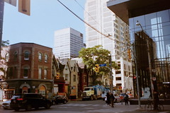 Bay St. (Lumad21) Tags: toronto canada downtown 35mm olympus pointandshoot streetphotography analog city people buildings traffic