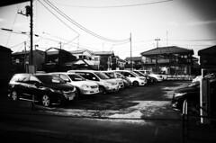 (ademilo) Tags: street streetphotography streetlight city cityscape citylife car parking monochrome blackandwhite sky tokyo town townscape transportation japan gr2 gr