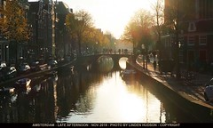 BACKLIT CANAL - GOLDEN LIGHT (lindenhud1) Tags: amsterdam golden sun sunlight orange beautiful lateafternoon canal sky street buildings holland netherlands europe travel art gorgeous incredible heavenly people afternoon peaceful artistic artphotography water beautifulscene hazy dreamy picturesque scenery amazing splendid