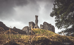 A wreck of former glory (Through_Urizen) Tags: architecture category decay devon england external hdr okehampton places canon canon1585mm canon70d outdoor outside medieval castle fort stone stonebuilding fortress hill gass wall trees greyskies uk unitedkingdom greatbritain