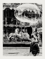 Happiness is a soap bubble that changes color like the iris and bursts when touched. (streetspirit13) Tags: bw streetphotographer candidstreetphotography soap