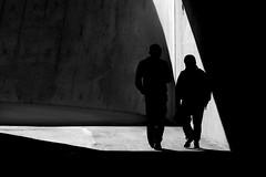 silhouette of two guys (heinzkren) Tags: schwarzweis blackandwhite biancoetnero noiretblanc monochrome street streetphotography silhouette light shadow licht schatten canon eosr men burschen knaben männer