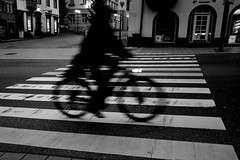 Ghost Rider (stefankamert) Tags: street crossing rider blur blurry motionblur lines highcontrast night bicycle stefankamert ricoh gr griii ricohgriii 28mm noir noiretblanc blackandwhite blackwhite rottweil people