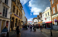 Exploring historic Canterbury, England (` Toshio ') Tags: toshio canterbury england unitedkingdom greatbritain europe european europeanunion city medieval people store street sidewalk clouds fujixt2 xt2 shopping