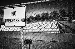 No Trespassing - Out of Season (alhawley) Tags: ricohgrii street streetphotography american americanabstract americana blackandwhite bw everytownusa grain gritty highcontrast monochrome shadow usa chainlink swimmingpool empty pool trix mundane ricoh arebureboke