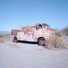 texaco. desert center, ca. 2019. (eyetwist) Tags: eyetwistkevinballuff eyetwist 1951 gmc coe fuel truck desertcenter abandoned rusty bleak desert california mamiya 6mf 50mm kodak portra 160 mamiya6mf mamiya50mmf4l kodakportra160 ishootfilm ishootkodak analog analogue film mamiya6 square 6x6 mediumformat 120 primes filmexif iconla epsonv750pro lenstagger dirt sonorandesert dry americantypologies roadsideamerica lonely desolate barren american west postapocalyptic apocalypse decay derelict rust bucket junkyard caboverengine faded peeling lettering texaco gas gasoline diesel
