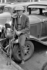 Soldiering On: A war veteran who sells pencils on the streets. Omaha, Nebraska, November 1938. (polkbritton) Tags: johnvachon fsaowi nebraskahistory 1930s vintagefashion classiccars streetphotography libraryofcongresscollections worldwari veteran greatdepression