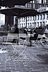A few chairs in the 'street' public plaza (sjnnyny) Tags: mepa westvillage west14street alfresco d750 stevenj sjnnyny manhattan streetscape streetview popularattraction nyc streetphotography urban