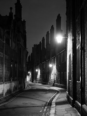 Trinity Lane (davepickettphotographer) Tags: cambridge uk eastanglia england britain cambridgeuniversity night evening blackandwhitephotography eastern midlands street photography cambridgeshire streetlights trinitylane college colleges streetlife