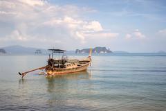 Long tailed boat (Katya_N) Tags: andamansea horizontal kohyaonoi longtailedboat nopeople photography reflection rockformation thailand touristattraction tranquil traveldestination