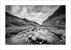 Momentary V (Frank Hoogeboom) Tags: wales unitedkingdom uk pass llanberis nature landscape outdoors travel snowdonia nationalpark reserve river mountains valley welsh blackandwhite mono monochrome fineart depth water rock stones shallow creek stream clouds dramatic scenic