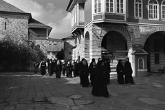Mass Time  (Tri-X) (Harald Philipp) Tags: mediterranean monastery monks orthodox athos greece europe european tourism destination travel adventure wanderlust architecture atmosphere haraldphilipp blackandwhite bw blackwhite monochrome schwarzweiss nocolor contrast moody trix tx400 kodak 135 35mm iso400 film grain analog filmphotography selfdevelop homedevelop ufg ethol nikon nikkor slr fm3a nikon5000ed 5000ed coolscan