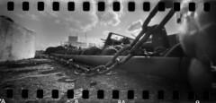 2581 Chained. (Monobod 1) Tags: ondu 135 panoramic expired ilford hp5 rodinal pinhole lensless epsonv800