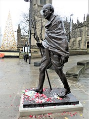 Gandhi = new statue in Manchester = unveiled 25.11.2019. = NOTE THE ZENITH SILVER POCKET WATCH !!! AT 2.50PM = given to him by Indira Nehru (rossendale2016) Tags: new city statue bronze manchester foot centre nine gandhi tall feet floor taller lifelike november flowers england church rain weather fantastic shiny icon poppies bunch bouquet raining iconic daffodils 2019 road traffic pavement path pedestrian walkway excellent roadside mahatma immaculate leather walking sandals bare barefoot stick christmas up lights lit watch chain note pocket fob glasses wire framed moustache spectacles lancashire fabric cotton mills boycott silver zenith nehru indira support stave wood wooden long bamboo