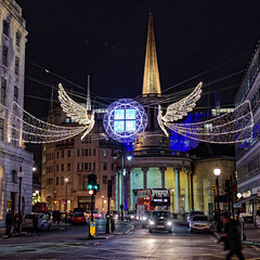 Langham Place (Croydon Clicker) Tags: london westend night lights christmas street road traffic people decorations angel church spire