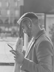 through the umbrella and into the sun (marco monetti) Tags: streetportrait ritrattodistrada streetphotography fotografiadistrada contralux contoluce umbrella ombrello smartphone cigarette sigaretta boy ragazzo man uomo