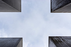 Sky is the Limit (cs_one) Tags: installation extermination memorial historic grief blocks fascism genocide berlin commemoration monoliths geometric shoah wwii black death concrete europe stone beton holocaust wall labyrinthe landmark cube ww2 square jewish perspective texture judaism famous secondworldwar symbol rectangular grey remembrance dark monument history germany meditating sign victims block holocaustmemorial
