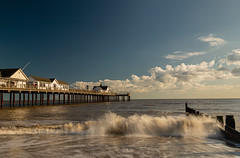 The Pier (selvagedavid38) Tags: sea northsea coast beach waves tide water pier sand suffolk southwold ocean movement motion blue sky clouds buildings seaside