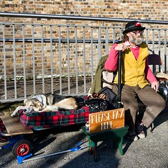 The book man (sasastro) Tags: kingscross regentscanal towpath wordonthewater barge hat dog streetphotography street candid
