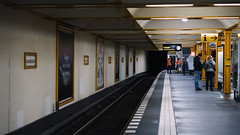 UBahn station Berlin (justahero) Tags: berlin ubahn naturkundemuseum platform people night nightphotography rails