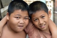 a young thai mohammad ali and friend (the foreign photographer - ฝรั่งถ่) Tags: two boys children khlong thanon portraits bangkhen bangkok thailand nikon d3200