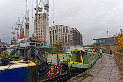 Old and New (Croydon Clicker) Tags: canal boats barges water mooring towpath building architecture kingscross london nikon nikkoraf28105mmd cranes people