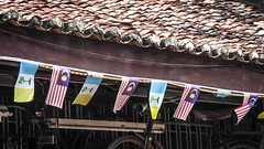 Bunting of mini Penang and Malaysian flags (Theen ...) Tags: malaysia tiles 2018 lumix mini shot armenianstreet bunting fascia flagspenang roof theen terracotta patriotism election