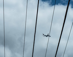 Airbus A350 among the wires (MarkAurelius) Tags: airliner flight landing approach landinggear airbusa350 brisbane wires powerlines clouds sky