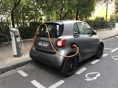 Saving Juice (Melinda * Young) Tags: chargingstation smart renewable plug picture logo street paris city urban parked hookedup hose stop fuel juice charge car electric