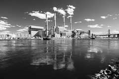 Ravenswood Generating Station (Adventures in Infrared) (Torsten Reimer) Tags: eastriver wasser usa fluss boot reflektionen northamerica industrial himmel reflections ravenswoodgeneratingstation spiegelungen water queensborobridge boat clouds kamin schwarzweis unitedstatesofamerica monochrome blackandwhite infrared river nyc newyorkcity canoneosm6 sky chimneys powerstation infrarot wolken newyork