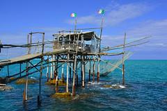 DSC_0049a (carlocorv1) Tags: costruzione legno pali acqua cielo bandiere pesca ristorante mare blu rete macchina pesci menù