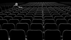 the best seat? (gro57074@bigpond.net.au) Tags: paralysis paradoxofchoice choice thebestseat patterned contrast candid man f50 2470mmf28 tamron d850 nikon townhall sydney november2019 isolation guyclift bw monochromatic monochrome mono blackwhite
