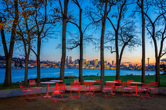 Red Chairs (KPortin) Tags: chairs seattle skyline spaceneedle gasworkspark trees lakeunion