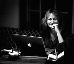 My girl hard at work (uofmtiger) Tags: woman blackandwhite beautiful working macbook