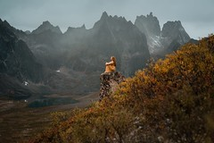Tombstone Solace (Elizabeth Gadd) Tags: tombstones tombstone territorial park yukon north canada mountains landscape grizzly lake autumn fall bushes tundra yellow gold orange woman girl lady dress sitting rock moody weather dark sky portrait nature