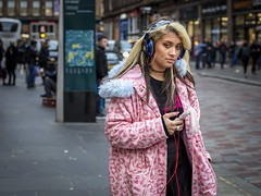 Tuned In (Leanne Boulton) Tags: urban street candid portrait portraiture streetphotography candidstreetphotography candidportrait streetportrait eyecontact candideyecontact streetlife woman female girl face eyes expression mood emotion feeling atmosphere pink blue fur hood smartphone headphones hair style fashion alternative piercing tone texture detail depthoffield bokeh naturallight outdoor light shade city scene human life living humanity society culture lifestyle people canon canon5dmkiii 50mm primelens ef50mmf14usm colour glasgow scotland uk
