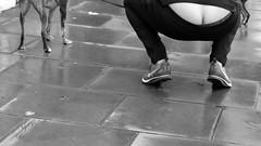 Owner setting bad example.... (markwilkins64) Tags: streetphotography street candid blackandwhite bw monochrome mono pavement dog crouch bum bottom crack arse arsecrack buildersbum markwilkins