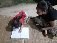 Esther doing homework 2 (SierraSunrise) Tags: thailand phonphisai nongkhai isaan esarn banmai homework children