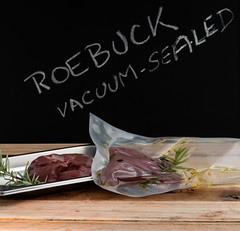 Vacuum-sealed roebuck (annick vanderschelden) Tags: roebuck meat fat protein deer roedeer food cooking bamboo cuttingboard venison animal saturatedfat cholesterol sodium potassium iron culinary polyethylene bag plastic oliveoil herb spice rosemary thyme blackpepper belgium