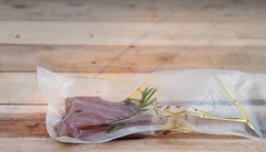 Roebuck vacuum-packed (annick vanderschelden) Tags: roebuck meat fat protein deer roedeer food cooking bamboo cuttingboard venison animal saturatedfat cholesterol sodium potassium iron culinary polyethylene bag plastic oliveoil herb spice rosemary thyme blackpepper belgium