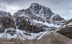The rugged mountain (Photosuze) Tags: rockies canadianrockies mountain banffnationalpark canada landscape rugged snow sky clouds gloomy