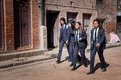 Students on their way to study in the morning. (Goran Bangkok) Tags: nepal girls boys students bhaktapur street city morning streetphotography streetphoto fujixt3