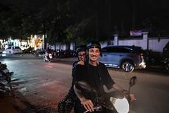 Thursday hangout (Cadicxv8) Tags: night nightphotography street streetphotography motorcycle people couple smile saigon friendly