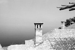 Goodbye Athos  (Tri-X) (Harald Philipp) Tags: architecture sea seascape aegean structure roof building chimney monastery mediterranean christian religion orthodox athos greece europe european tourism destination travel adventure wanderlust atmosphere haraldphilipp blackandwhite bw blackwhite monochrome schwarzweiss nocolor contrast moody trix tx400 kodak 135 35mm iso400 film grain analog filmphotography selfdevelop homedevelop xtol nikon nikkor slr fm3a nikon5000ed 5000ed coolscan