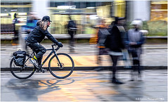 Coming Through! (Fermat 48) Tags: cyclist cycle bike stpeterssqusre manchester motion rain wet canon eos 7dmarkii wheels reflection light