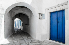Blue is the color of summer (Rabican7) Tags: greece blue summer island tinosisland tinos door wooden arch village arches alley empty street windows greek cycladic cyclades white bright color shade sunlight pyrgos