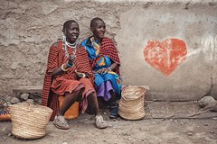 Tales Of A Lonely Heart (u c c r o w) Tags: arusha graffiti maasai women colorful market tanzania africa colors wall basket red streetlife street outside old